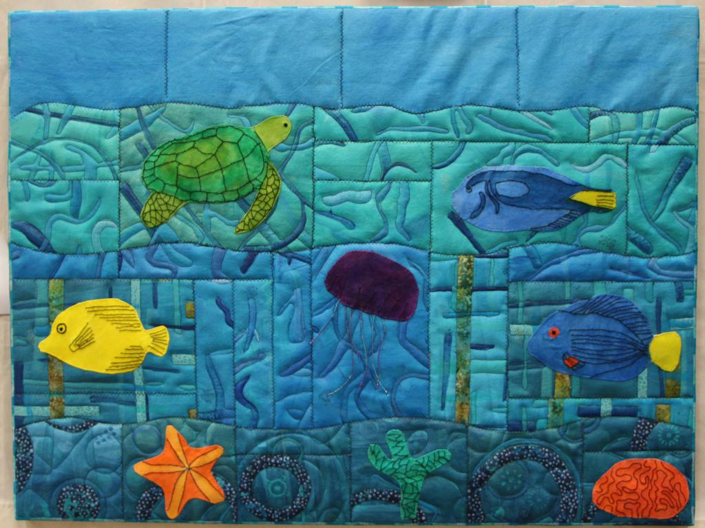 "35"" x 27.5""; Entered in the Cotton Patch Quilter's 2019 quilt show.  Watercolor painted tropical fish on zigzag stitched canvas.  It hangs in my office."