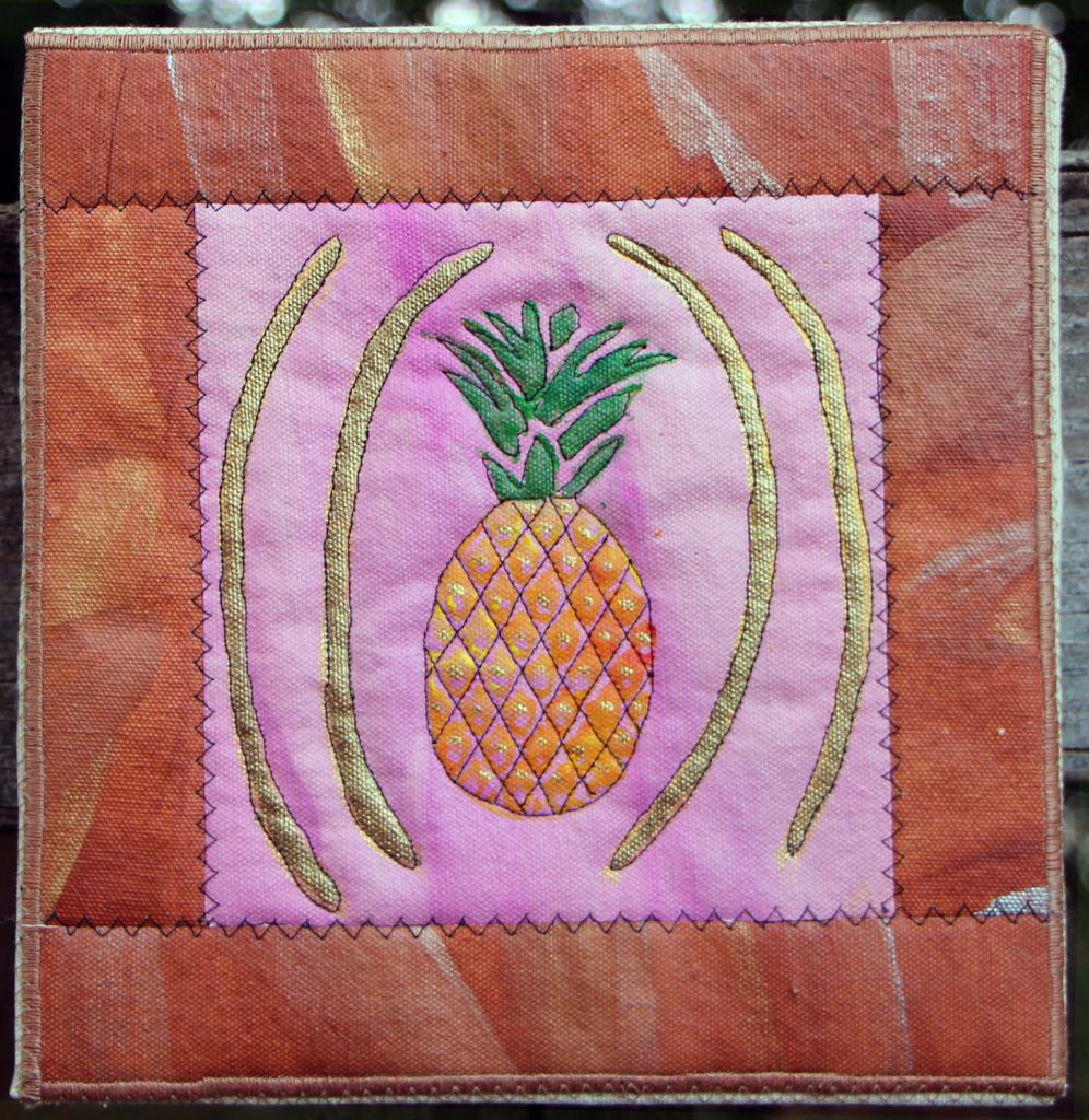 Pineapple  with gold accents on pink with tan accented border