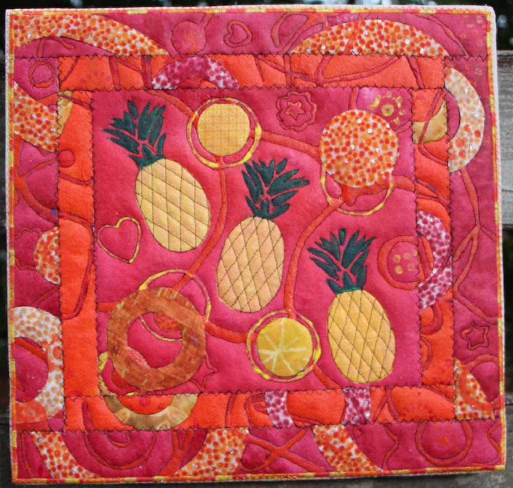Tumbling Pineapples on red with orange