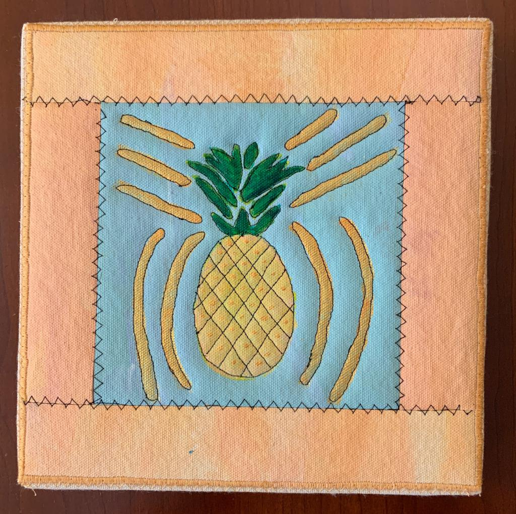 Pineapple with gold accents on blue with peach border